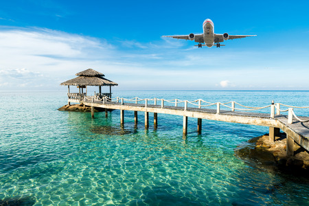 island paradise: Airplane is arriving tropical resort in the morning. Travel, Summer, Vacation and Holiday concept. Stock Photo