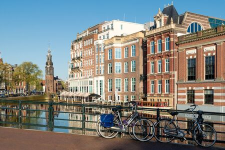 amsterdam canal: Bikes on the bridge with Netherlands traditional houses and Amsterdam canal in Amsterdam ,Netherlands. Stock Photo