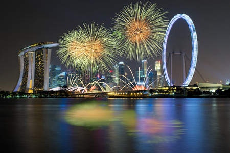 Fireworks celebration over Marina bay in Singapore. New year day 2017 celebration at Singapore. Banco de Imagens