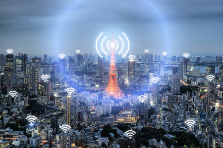 Wifi icon and Tokyo city with network connection concept, Tokyo smart city and wireless communication network, abstract image visual, internet of things. Stock Photo