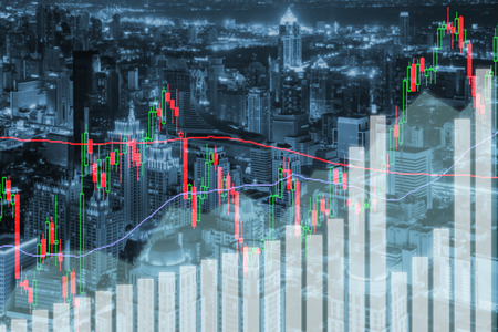 financial market: Trading stock market graph and bar on city at night. Business financial and trading concept