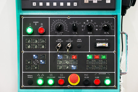 control panel lights: CNC machine control panel texture with lots of buttons in factory. Stock Photo