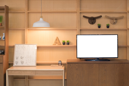 living style: Modern wood shelf with flat TV in living room at home. Living room interior. Stock Photo