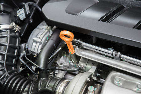 engine room: Closeup engine oil cap in engine room at modern car. Interior of car.