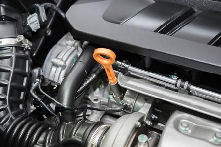 Closeup engine oil cap in engine room at modern car. Interior of car.