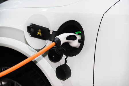 hybrid car: Power supply for hybrid electric car charging battery. Eco car concept.