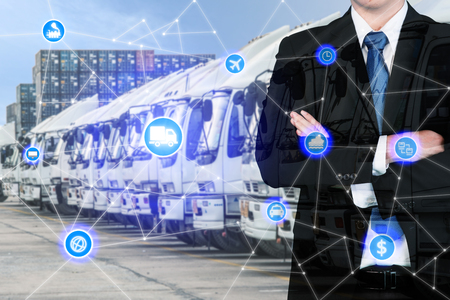 Double exposure businessman standing with his arms crossed with global business logistics system connection technology interface global partner connection