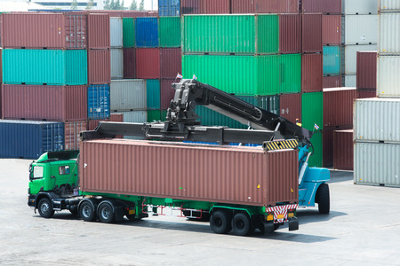container box: Forklift lift container box loading to truck in depot use for import export logistic background