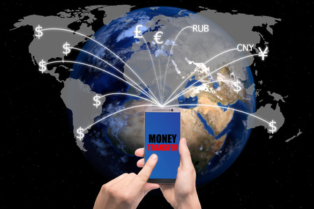 international money: Hand holding smart phone sent money flying away from screen to global map. Technology online banking money transfer, e-commerce concept.