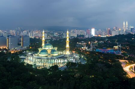 religious building: Aerial view of Federal Territory Mosque in night. Federal Territory Mosque is a major mosque in Kuala Lumpur, Malaysia