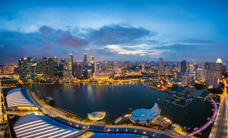 marina bay sand: Aerial view of Singapore business district and city at night in Singapore, Asia.
