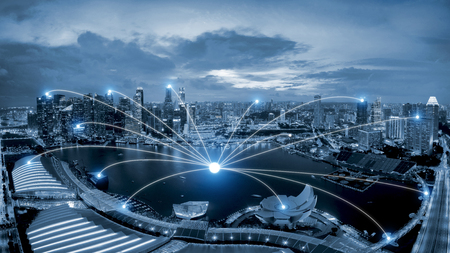 Network business conection system on Singapore smart city scape in background.Network business conection concept Imagens