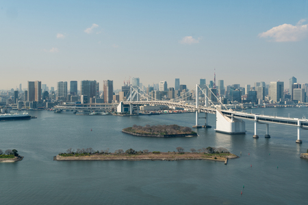 river: Tokyo Bay with a view of the Tokyo skyline and Rainbow Bridge in tokyo, Japan.