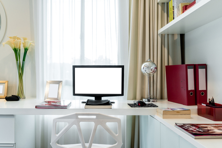 home office interior: Computer display and office tools on desk in home. Desktop computer screen isolated. Modern creative workspace background. Workspace at home.