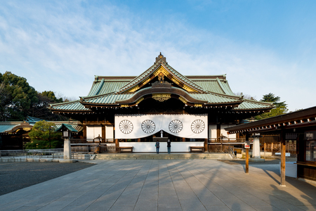 Japanese people praying at Yasukuni Shrine in Tokyo, Japan. Yasukuni shrine is one of the most famous Tourist spot in Tokyo, Japan