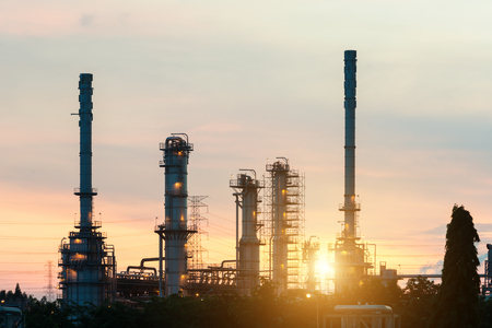 Landscape of oil refinery industry with oil storage tank in night. Stock Photo