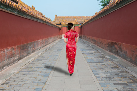 Asian young woman in old traditional Chinese dresses in the Forbidden city in Beijing, China. Banco de Imagens
