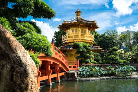 Front view the Golden pavilion temple with red bridge in Nan Lian garden, Hong Kong. Asia. 스톡 콘텐츠