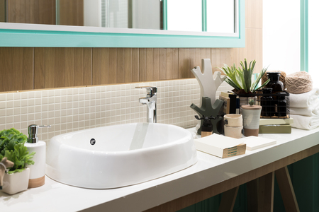 Interior of bathroom with sink basin faucet and mirror. Modern design of bathroom.