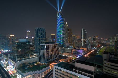 Night view with skyscraper in business district in Bangkok Thailand. Light show at Magnolias Ratchaprasong in Bangkok, Thailand. Stock Photo