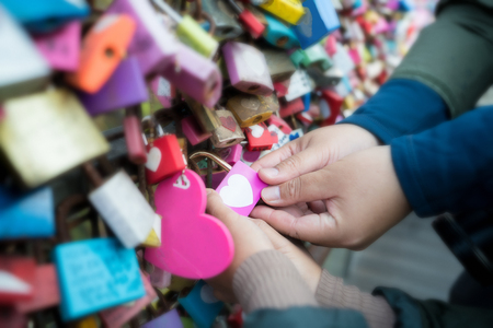 Touch of Heart. Couple lover hand touch heart master key in N Seoul tower in Seoul, South Korea. Stockfoto
