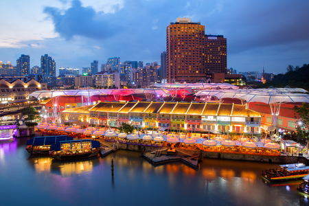 Colorful light building at night in Clarke Quay, Singapore. Clarke Quay, is a historical riverside quay in Singapore. Editorial