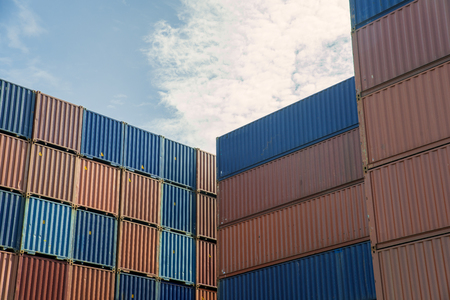 Stack of cargo containers at import and export area at port. Archivio Fotografico