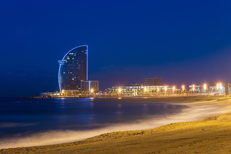 View of Barcelona Beach in summer night along seaside in Barcelona, Spain. Mediterranean Sea in Spain.