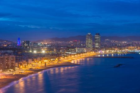 Aerial view of Barcelona Beach in summer night along seaside in Barcelona, Spain. Mediterranean Sea in Spain.