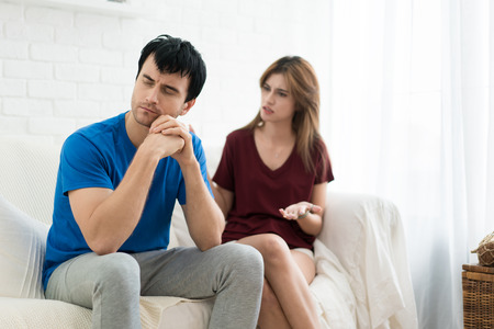 Couple having argument conflict, bad relationships. Angry fury woman screaming man stress in house.