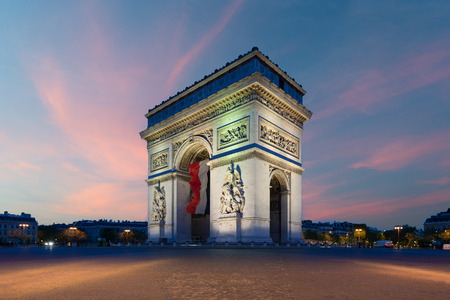Arc de Triomphe Paris and Champs Elysees with a large France flag flying under the arch in Europe victory day at Paris, France. 版權商用圖片