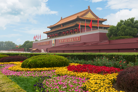 Beijing, CHian - October 20, 2017 : Tiananmen gate in Beijing, China. Chinese text on the red wall reads: Long live China and the unity of all peoples in the world.