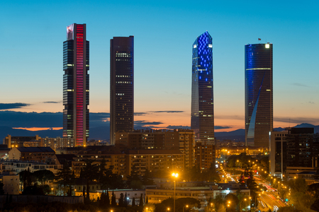 Madrid cityscape at night. Landscape of Madrid business building at Four Tower. Modern high building in business district area at Spain. Stok Fotoğraf