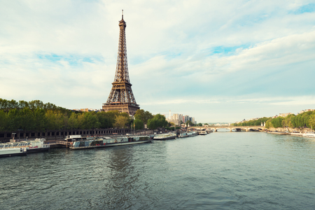 Eiffel tower in Paris from the river Seine in spring season. Paris, France.