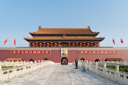 Tiananmen gate in Beijing, China. Chinese text on the red wall reads: Long live China and the unity of all peoples in the world.