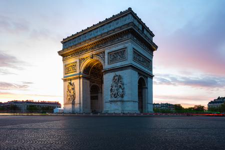 Paris street during sunrise with the Arc de Triomphe in Paris, France. Reklamní fotografie