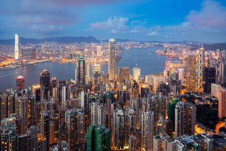 Hong Kong in Kowloon area skyline view from Victoria Peak in Hong Kong. Asian tourism, modern city life, or business finance and economy concept Imagens