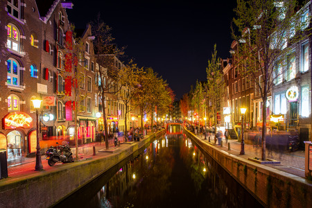 Red light district in Amsterdam, Netherlands at night. Nightlife in in Amsterdam, Netherlands