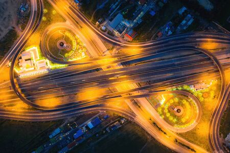 Aerial view of highway junctions Top view of Urban city, Bangkok at night, Thailand. Light trails across road junction, traffic abstract and transportation concept. Stock Photo