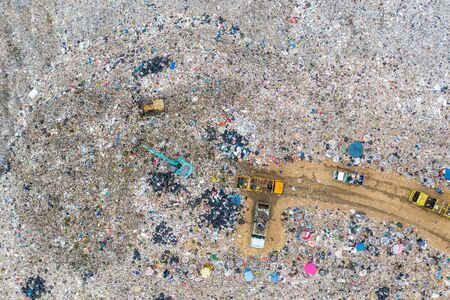 Garbage or waste Mountain or landfill, Aerial view garbage trucks unload garbage to a landfill. Plastic pollution crisis. industry and pollution global warning or recycle garbage concept Stock Photo - 131339786