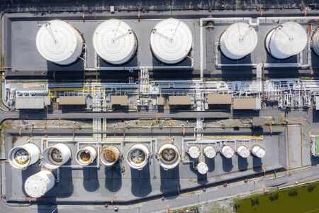 Aerial view of Chemical industry storage tank and tanker truck In wailting in Industrial Plant to tranfer oil to gas station. Fuel and power generation, petrochemical factory industry, or environmental pollution concept