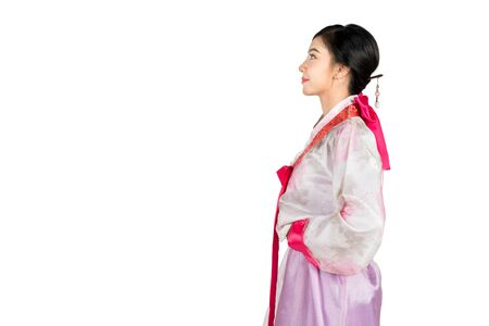 Portrait of young attractive Korean Woman with Hanbok, the traditional Korean dress smiling with white background  feeling confident and positive. Imagens - 132934237