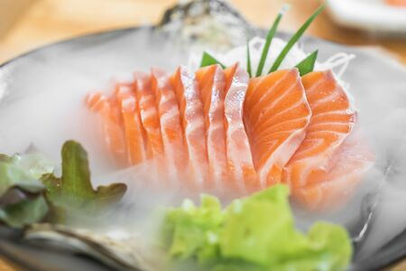 Japan raw salmon slice or salmon sashimi in Japanese style fresh serve on ice in Japanese restaurant. Japanese traditional food or with low calories and high nutrition and healthy diet dish.