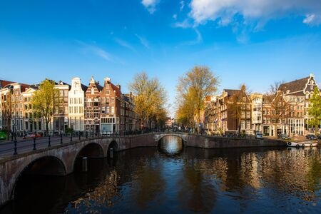 Canals of Amsterdam during sunset in Netherlands. Amsterdam is the capital and most populous city of the Netherlands. Landscape and culture travel, or historical building and sightseeing concept