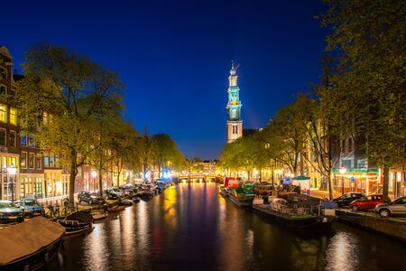 Canals of Amsterdam during twilight in Netherlands. Amsterdam is the capital and most populous city of the Netherlands. Landscape and culture travel, or historical building and sightseeing concept