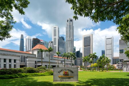 Singapore Parliament building in front of Singapore business district skyline financial downtown building at Marina Bay, Singapore. Asian tourism, modern city life, or business finance and economy concept Editorial