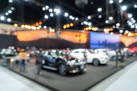 Blurred background of new cars displayed in luxury showroom with light bokeh, motor show event. 版權商用圖片