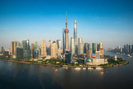Aerial view of Pudong skyline with Oriental Pearl tower and Lujiazui Business district skyscraper with Huangpu river in Shanghai, China. Asian tourism, modern city life, or business finance and economy concept Banco de Imagens
