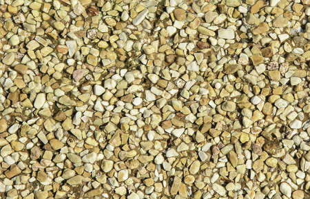 gravel beside swimming pool for background Stock Photo