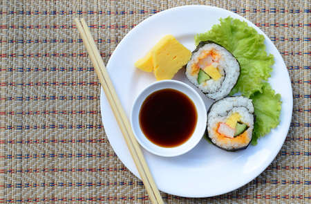 sushi on dish with sauce Stock Photo